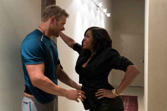 "Ali (Taraji P. Henson) hits on her neighbor (Kellan Lutz) after reading his mind in ""What Men Want."""