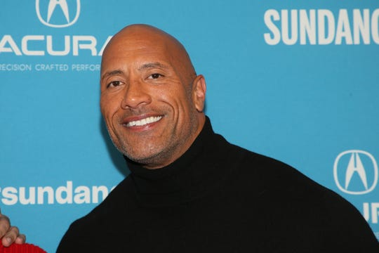 """Dwayne Johnson poses at the premiere of the film """"Fighting With My Family"""" during the 2019 Sundance Film Festival."""