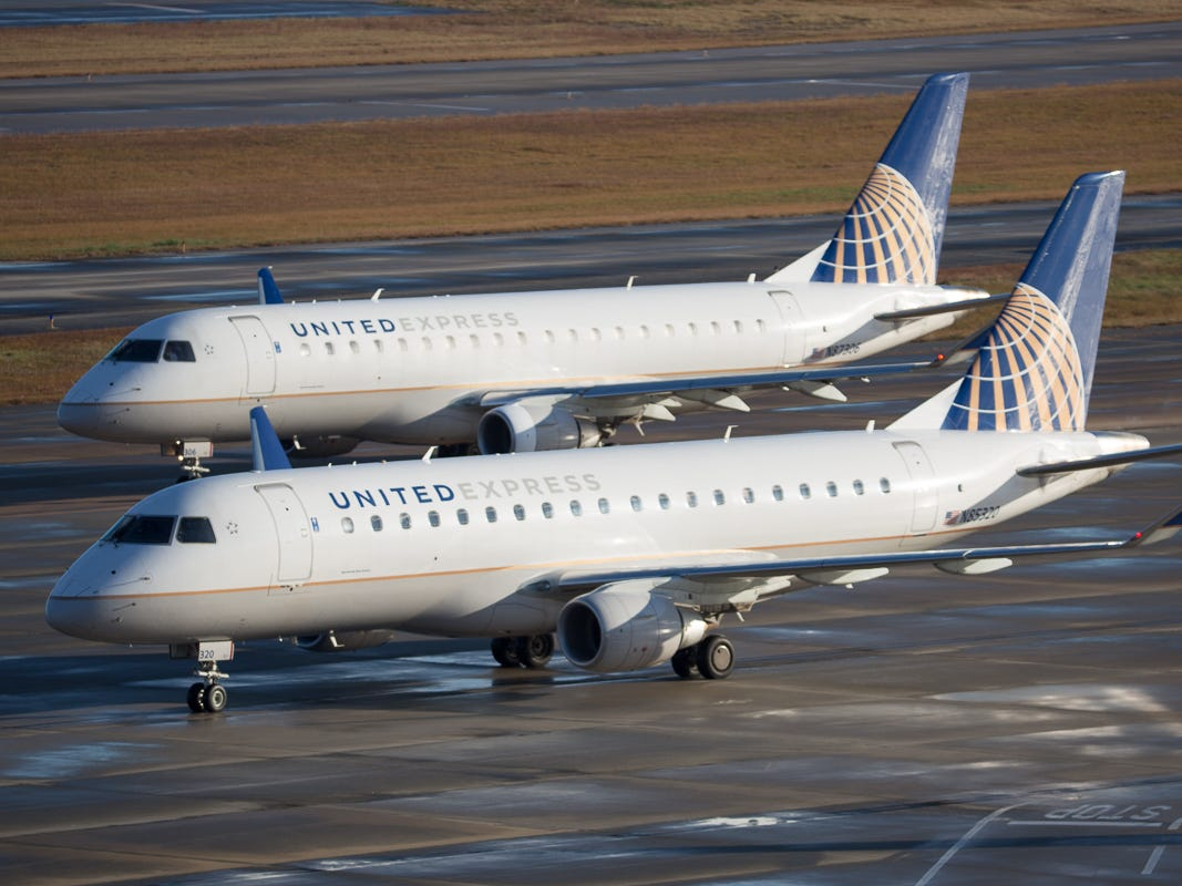 Two United Express Embraer E175s prepare for departure from George Bush Intercontinental Airport in Houston on Jan. 27, 2019.