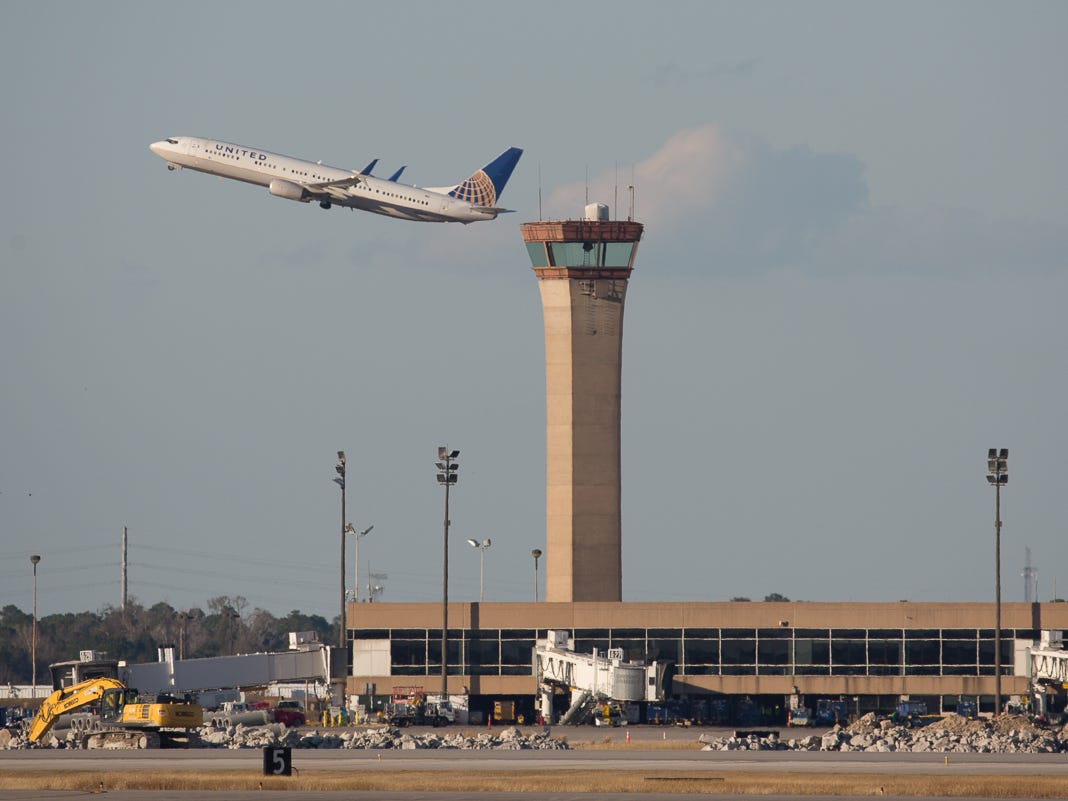 A United Airlines Boeing 737 takes off past the old tower at George Bush Intercontinental Airport in Houston on Jan. 27, 2019.