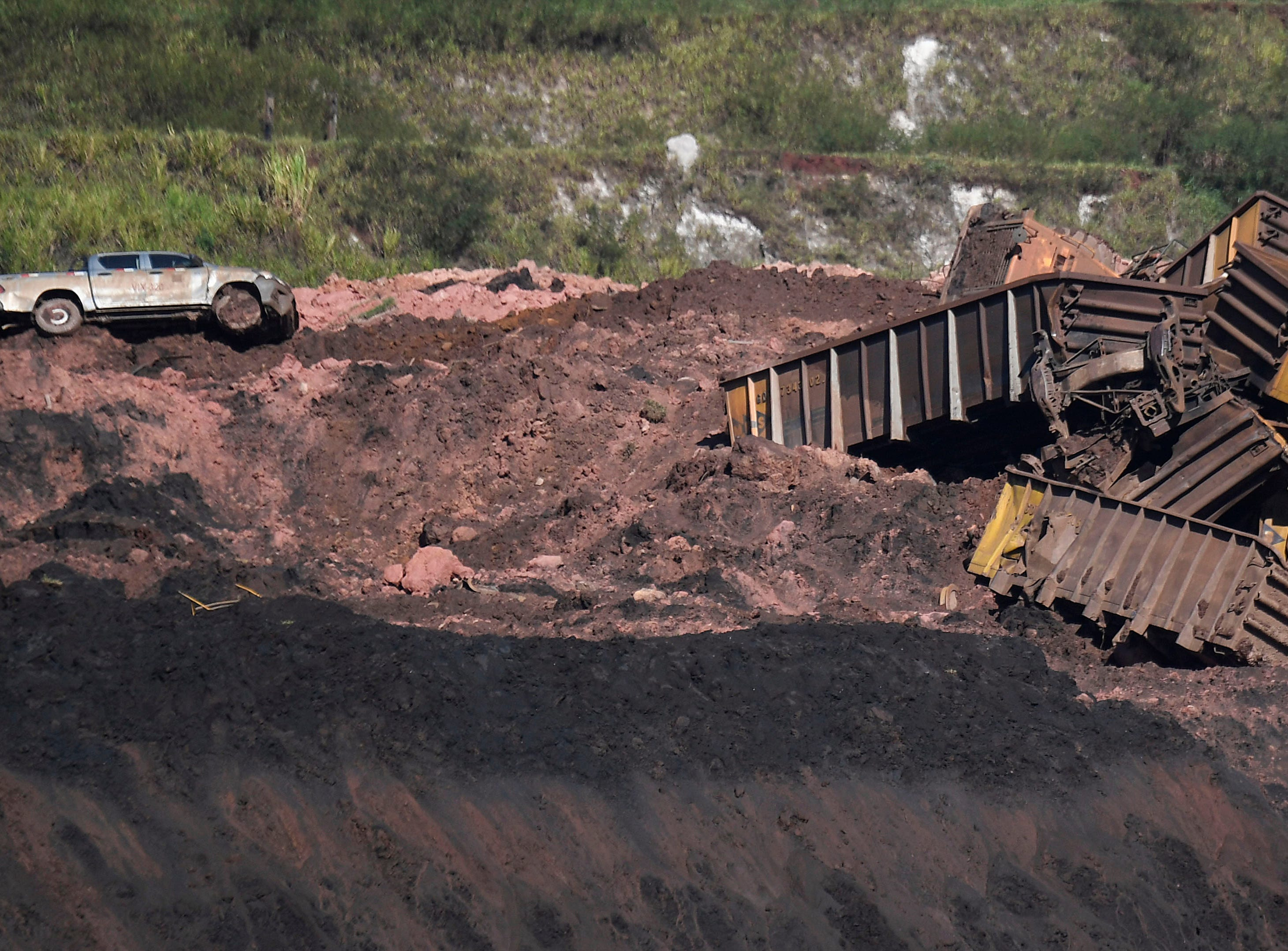 View of a semi-buried vehicle and debris at Corrego do Feijao where last January 25, a dam collapsed at an iron-ore mine belonging to Brazil's giant mining company Vale near the town of Brumadinho in the state of Minas Gerais in southeastern Brazil, on Jan. 31, 2019.