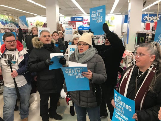 Protesters, including former workers from Sears, Kmart and Toys R Us, protest inside a Kmart store in Manhattan on Jan. 31, 2019, days before a federal judge decides the fate of Kmart parent company Sears Holdings.
