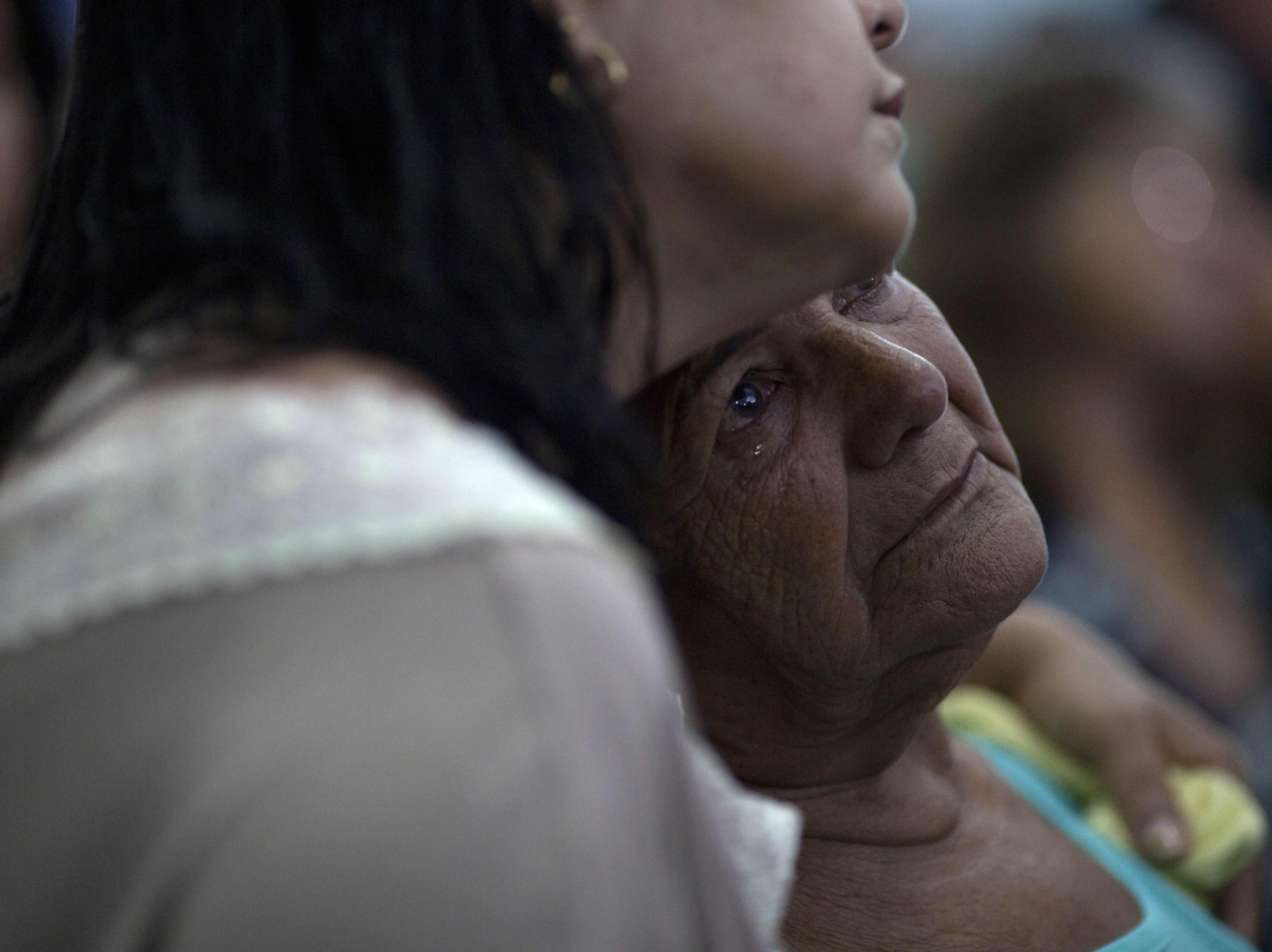 People pray during a service at the Brumadinho Matriz Church in honor of the missing people and victims in the community of Parque das Cachoeiras, after a dam belonging to Brazil's giant mining company Vale collapsed on January 25 near the city of Brumadinho in the state of Minas Gerais, southeastern Brazil, on Jan. 31, 2019.