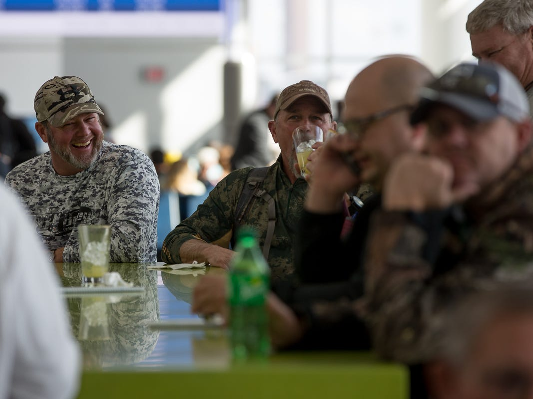 Passengers grab a drink before their flight at George Bush Intercontinental Airport in Houston on Jan. 27, 2019.
