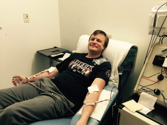 Jeramy Davies donates his stem cells to his anonymous donor.