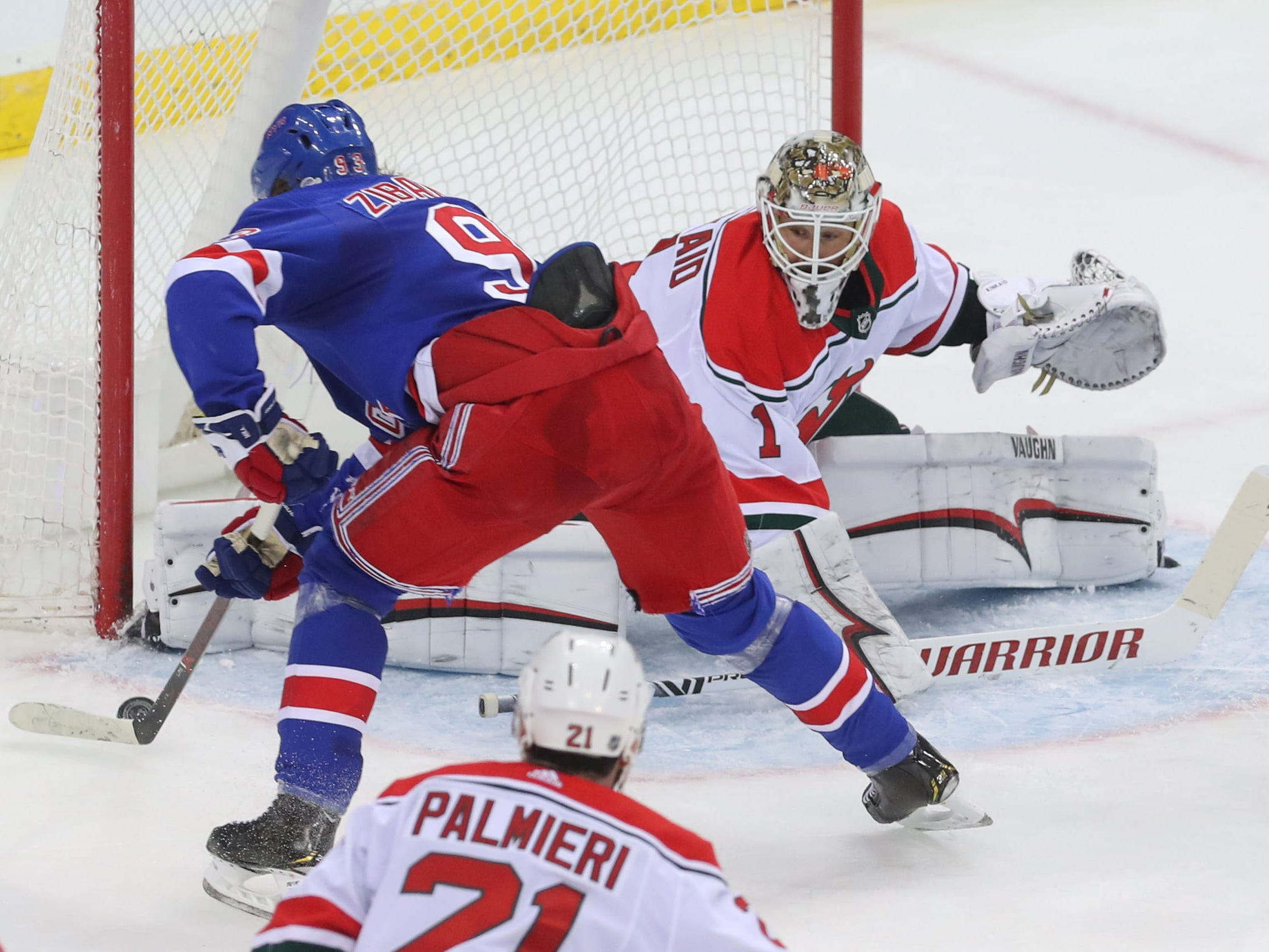 Jan. 31: New York Rangers center Mika Zibanejad scores against New Jersey Devils goaltender Keith Kinkaid. He had  a hat trick in the 4-3 victory.