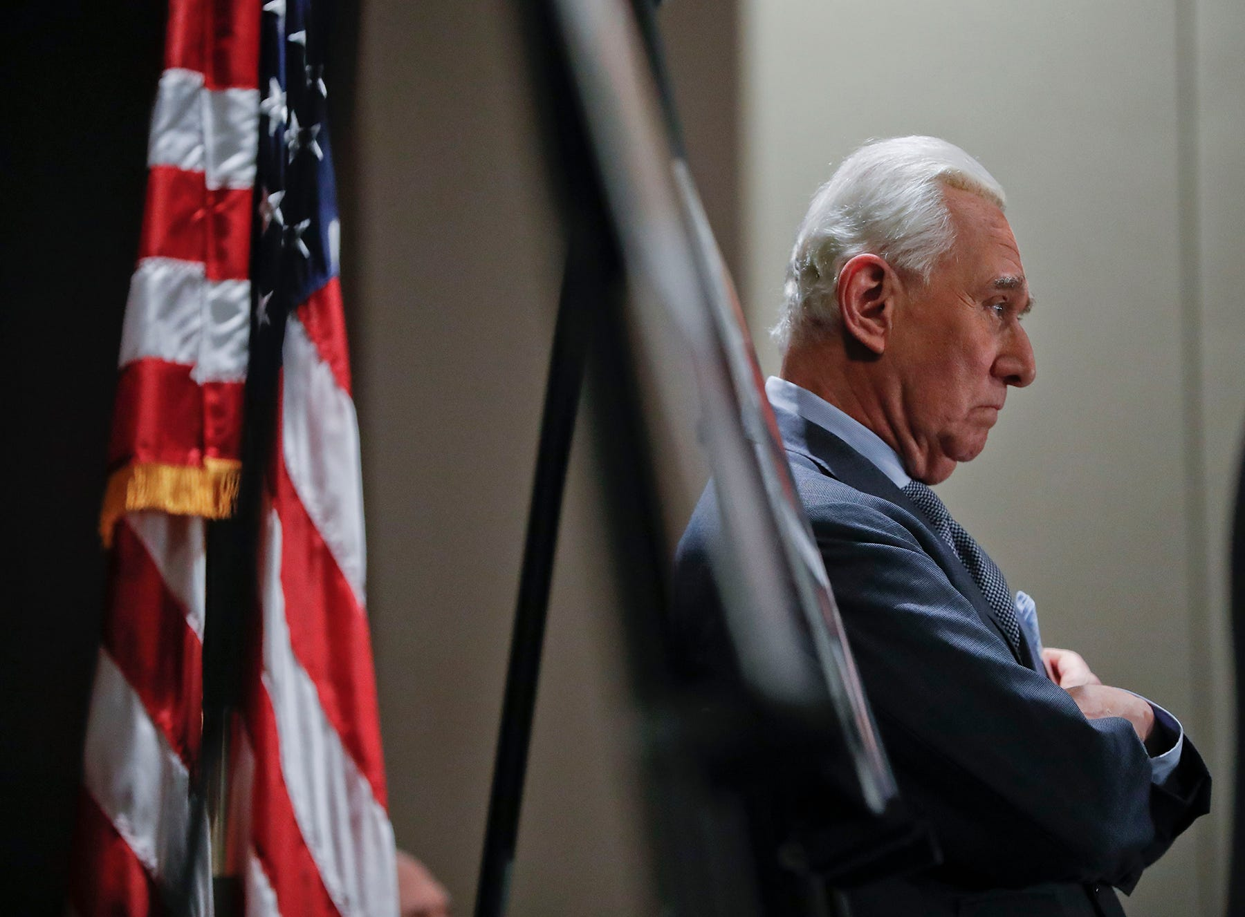 Roger Stone, longtime friend and confidant of President Donald Trump, waits to speak to members of the media in Washington, Thursday, Jan. 31, 2019.
