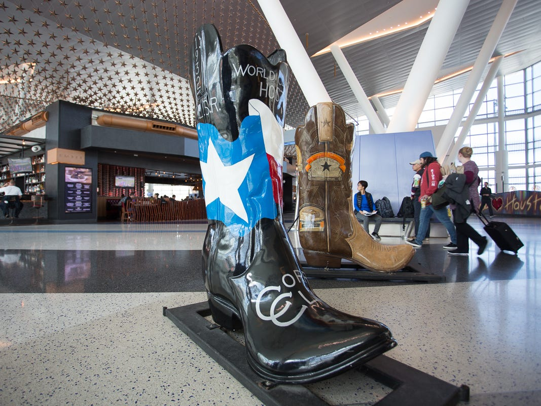 A giant cowboy boot adorned with the Texas flag sits in Terminal C at George Bush Intercontinental Airport in Houston on Jan. 27, 2019.