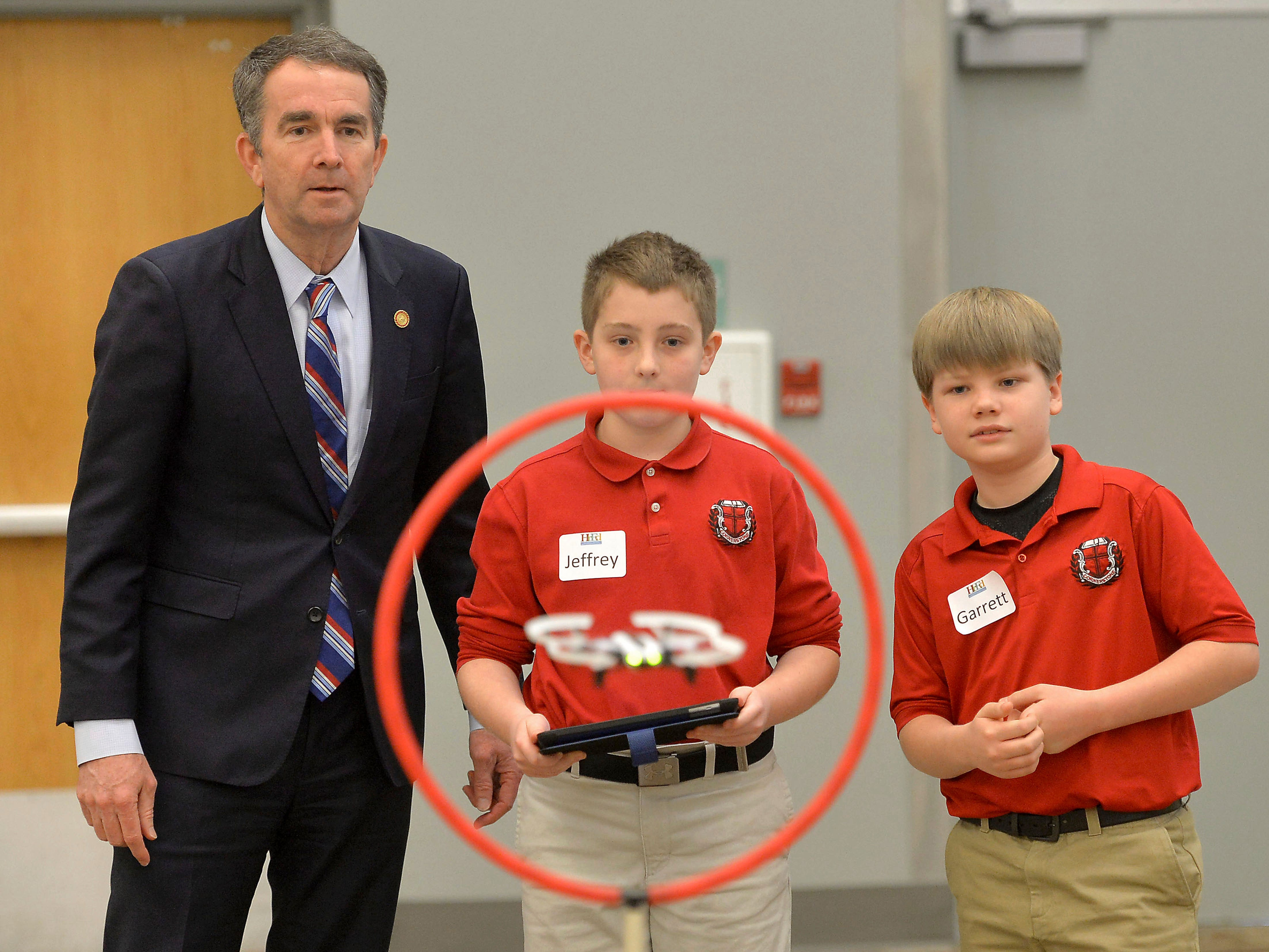 Virginia Governor Ralph Northam watches as Cornerstone Academy 5th graders Jeffery Taylor and Garrett Wakefield fly a programmed drone through a demonstration course at the Southwest Virginia Higher Education Center on Tuesday, Jan. 22, 2019, in Abingdon, Va. Northam was in Abingdon promoting Virginia Computer Science Education Week.