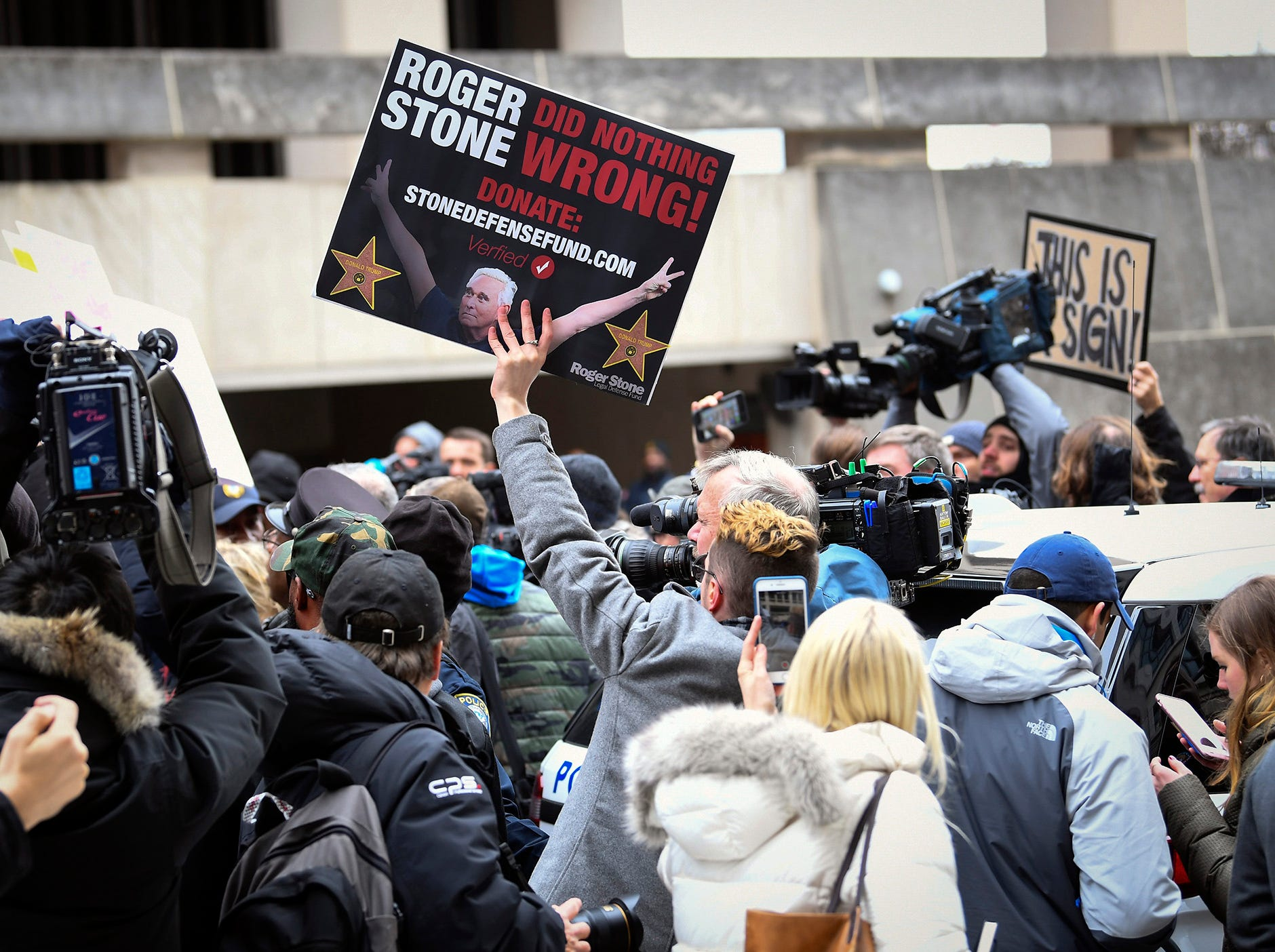 Protesters with signs as Roger Stone, a former political operative for the Trump campaign, departed following a federal court hearing on Jan. 29, 2019 in Washington. Stone was indicted on one count of obstruction, five counts of making false statements to Congress and one count of witness tampering.