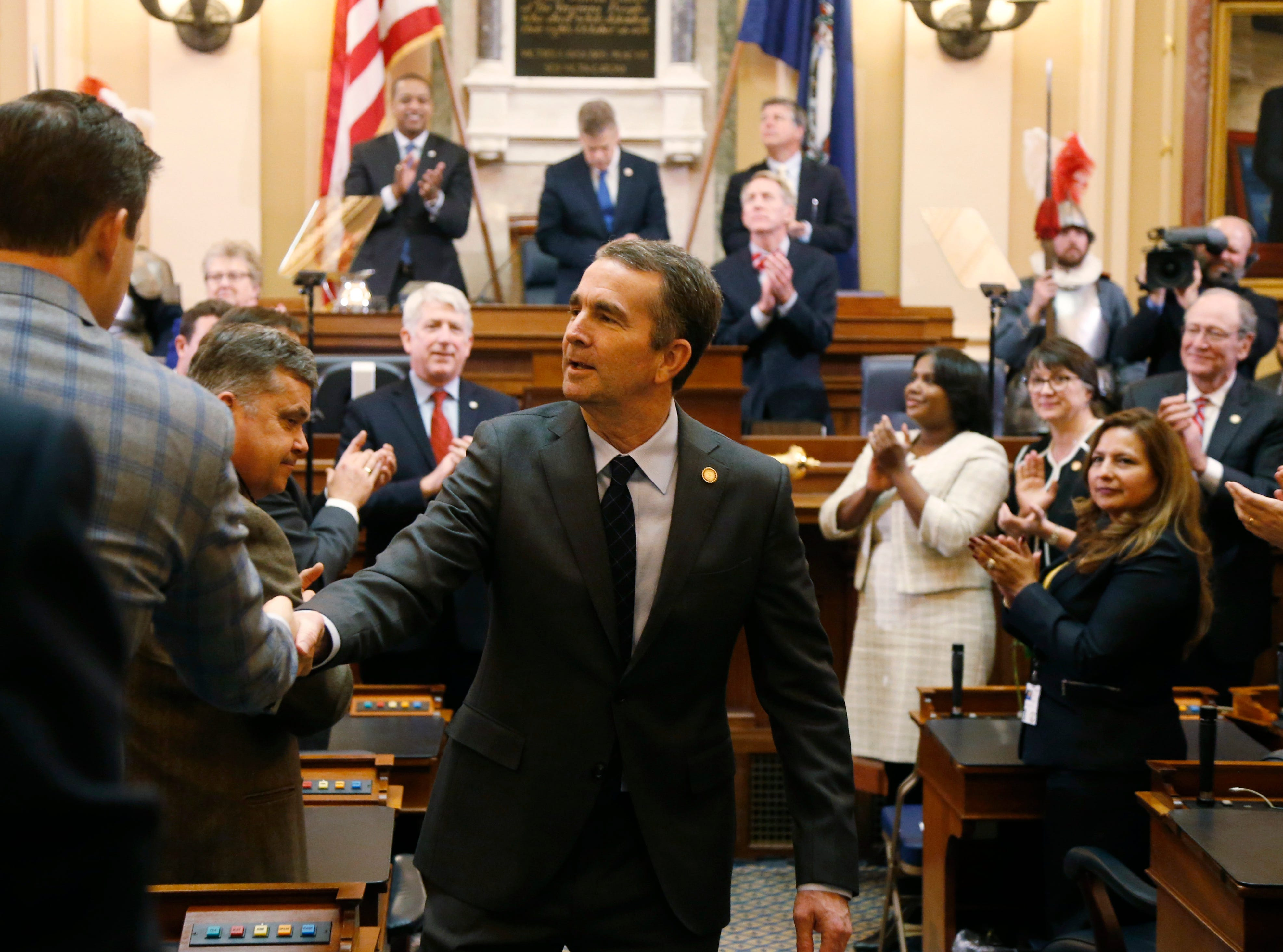 Virginia Gov. Ralph Northam shakes hands as he leaves the chambers after he delivered his State of the Commonwealth address during a joint session of the Virginia Legislature in the House chambers at the Capitol in Richmond, Va., Wednesday, Jan. 9, 2019.