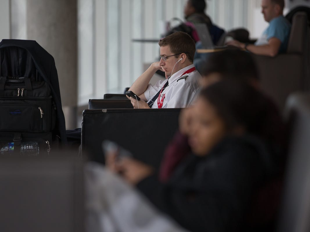 A pilot and passengers take a rest between flights at George Bush Intercontinental Airport in Houston on Jan. 27, 2019.