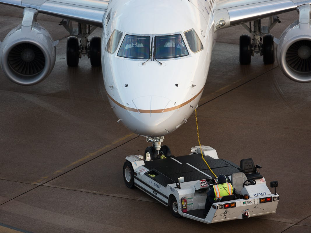 A United Express Embraer E175 is pushed back from the gate at George Bush Intercontinental Airport in Houston on Jan. 27, 2019.