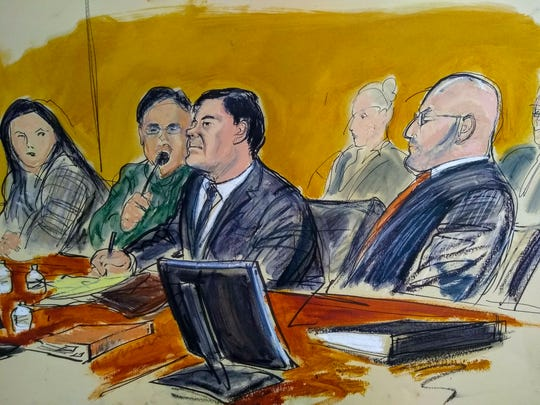 "In this courtroom sketch, Joaquín ""El Chapo"" Guzmán, center, and his attorney Eduardo Balazero, right, listen as a prosecutor delivers closing arguments during his trial Wednesday, Jan. 30, 2019, in New York City."