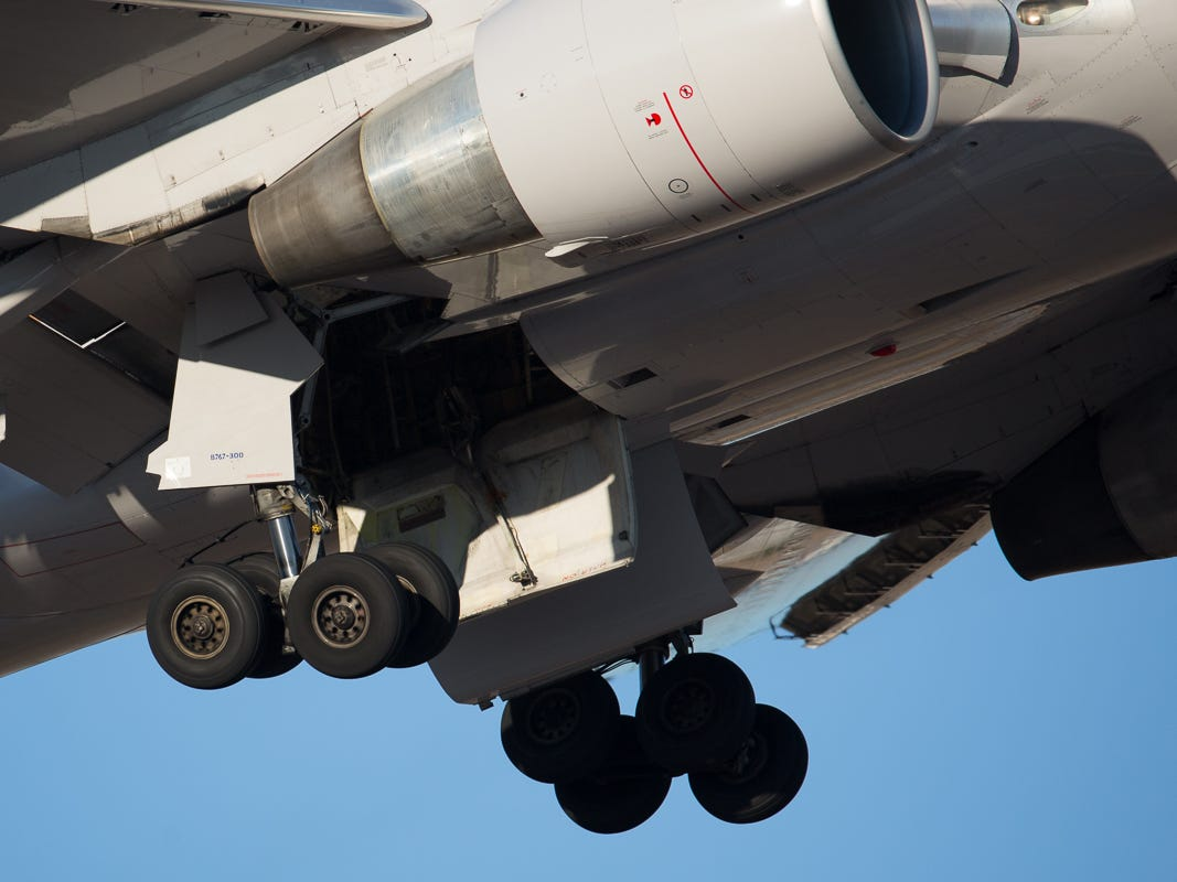 Wheels still spinning, the undercarriage of a United Airlines Boeing 767-300 is sucked up into the belly after taking off from George Bush Intercontinental Airport in Houston on Jan. 27, 2019.