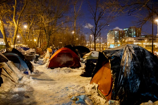 People sleep in tents near a wooded area adjacent to the Dan Ryan Expressway Tuesday Jan. 29, 2019, in Chicago.  Officials throughout the region were focused on protecting vulnerable people from the cold , including the homeless, seniors and those living in substandard housing. (Armando L. Sanchez/Chicago Tribune via AP)
