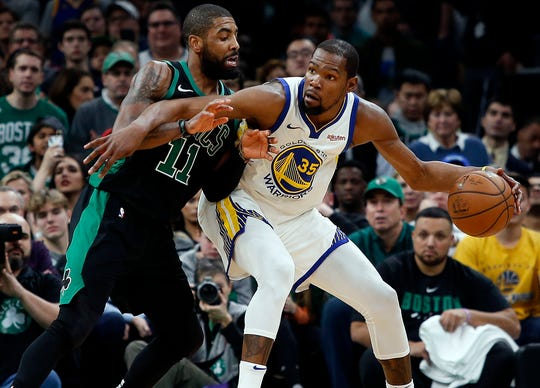 Kevin Durant (right) and Kyrie Irving could be headed to New York this summer.