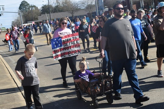 Marchers take part in a Right To Life event in Louisiana in February.