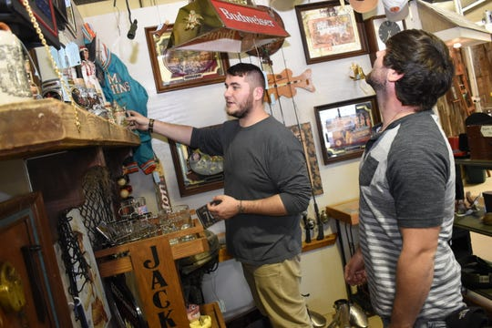 Todd Johnson (left) and his brother Boris Johnson look at items in Paw Paw's Man Cave booth at the Treasure Chest Too in Pineville. The new market recently opened in the old location where Fad 'n Frames was located on Highway 28 East.