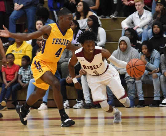 Pineville's Anthony Johnson (1) tries to drive against Alexandria Senior High School Friday, Feb. 1, 2019. Pineville won 63-60 in double overtime.