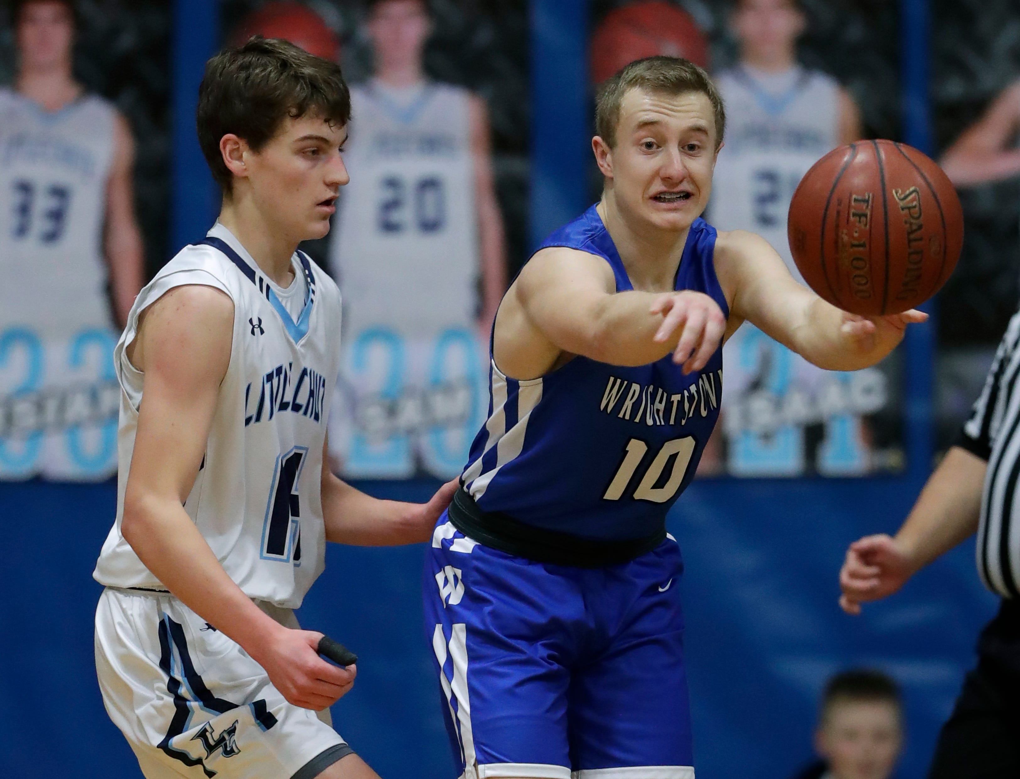 Little Chute High School's Logan Plate (14) defends against Wrightstown High School's Tyler Kroes (10) during their boys basketball game Friday, February 1, 2019, in Little Chute, Wis. 