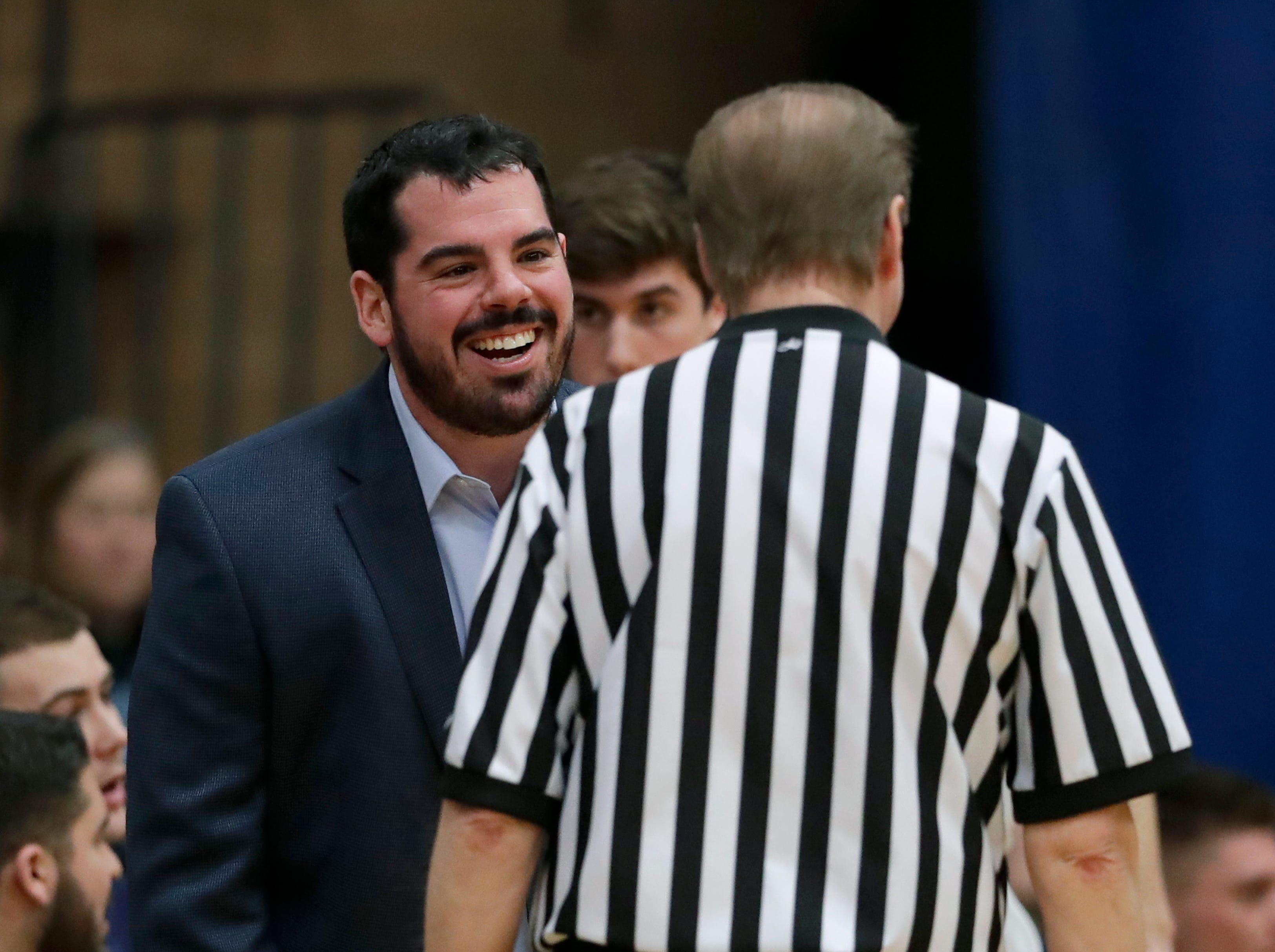 Little Chute High School's coach Jake VanRoy talks with an official after a play against Wrightstown High School during their boys basketball game Friday, February 1, 2019, in Little Chute, Wis. 