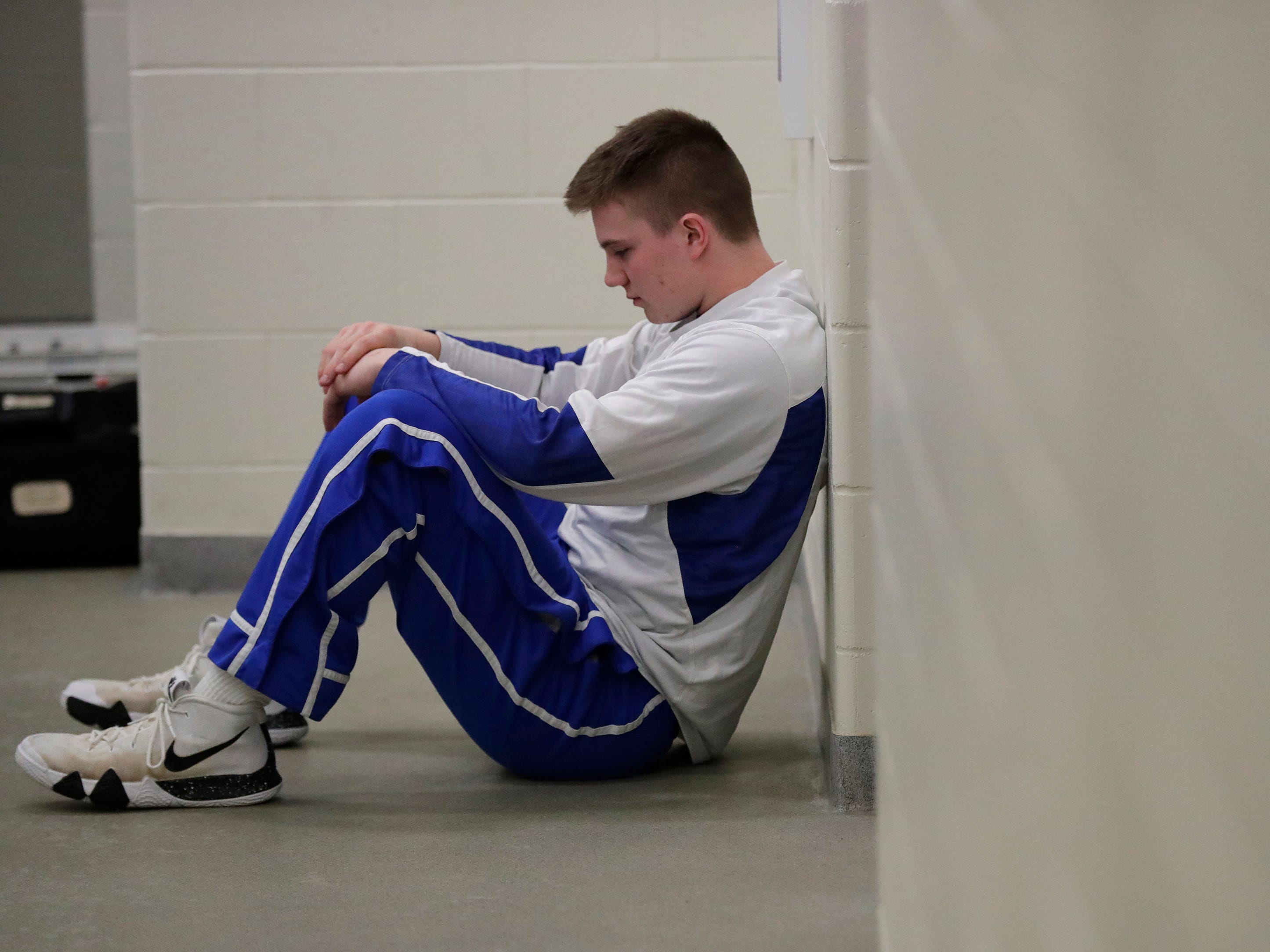 Wrightstown High School's Ben Jaeger waits in the locker room to play against Little Chute High School moments before their boys basketball game Friday, February 1, 2019, in Little Chute, Wis. 