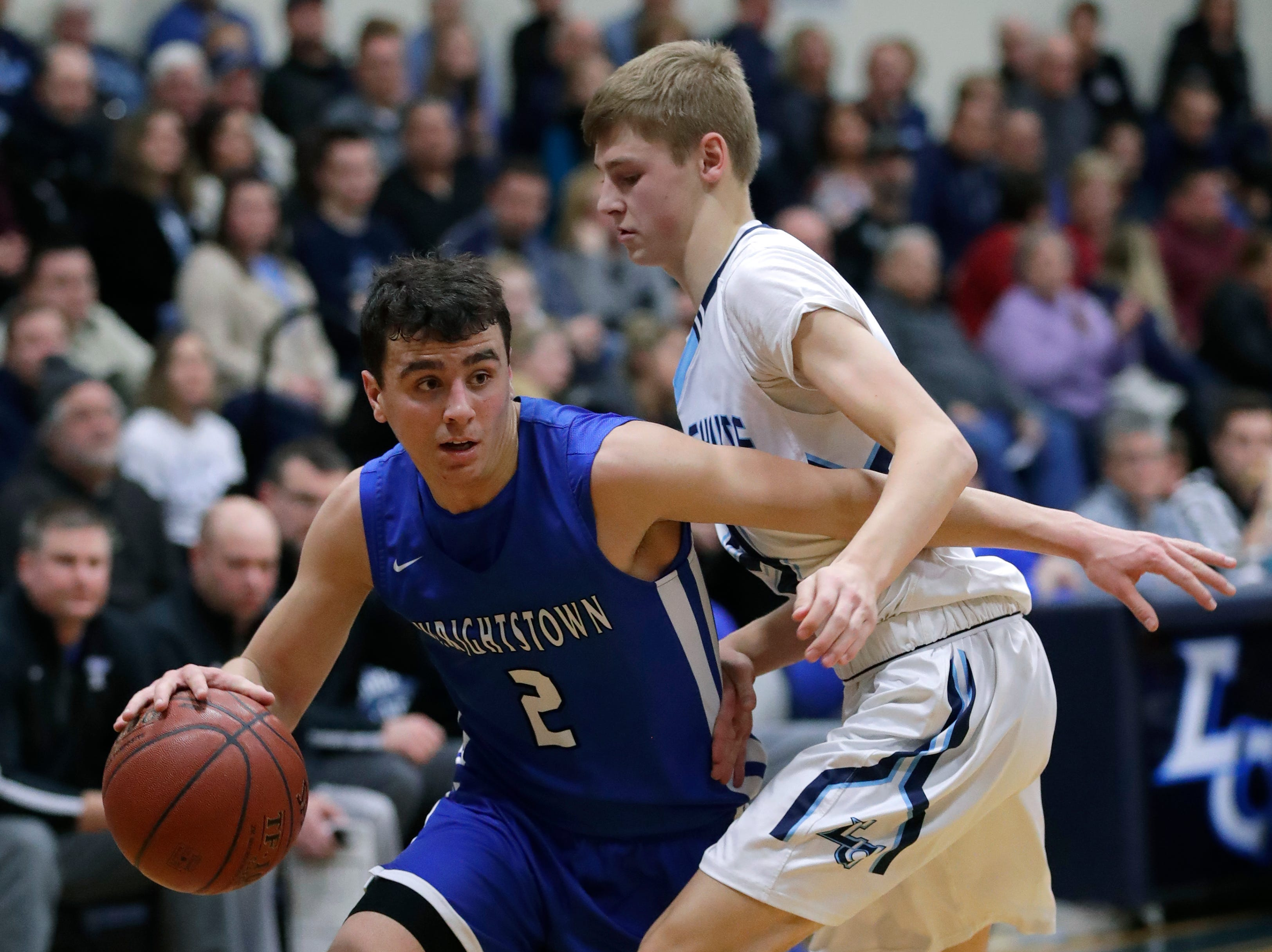Wrightstown High School's Jeremy Van Zeeland (2) drives to the basket against Little Chute High School's  Justin Job (3) during their boys basketball game Friday, February 1, 2019, in Little Chute, Wis. 