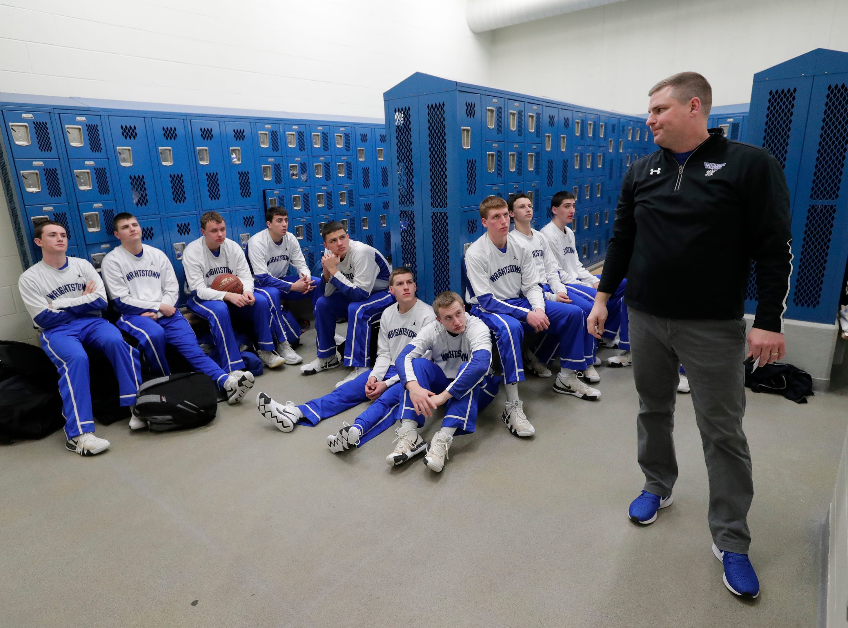 Wrightstown High School's coach Cory Haese talks to his players prior to taking to the court against Little Chute High School during their boys basketball game Friday, February 1, 2019, in Little Chute, Wis. 