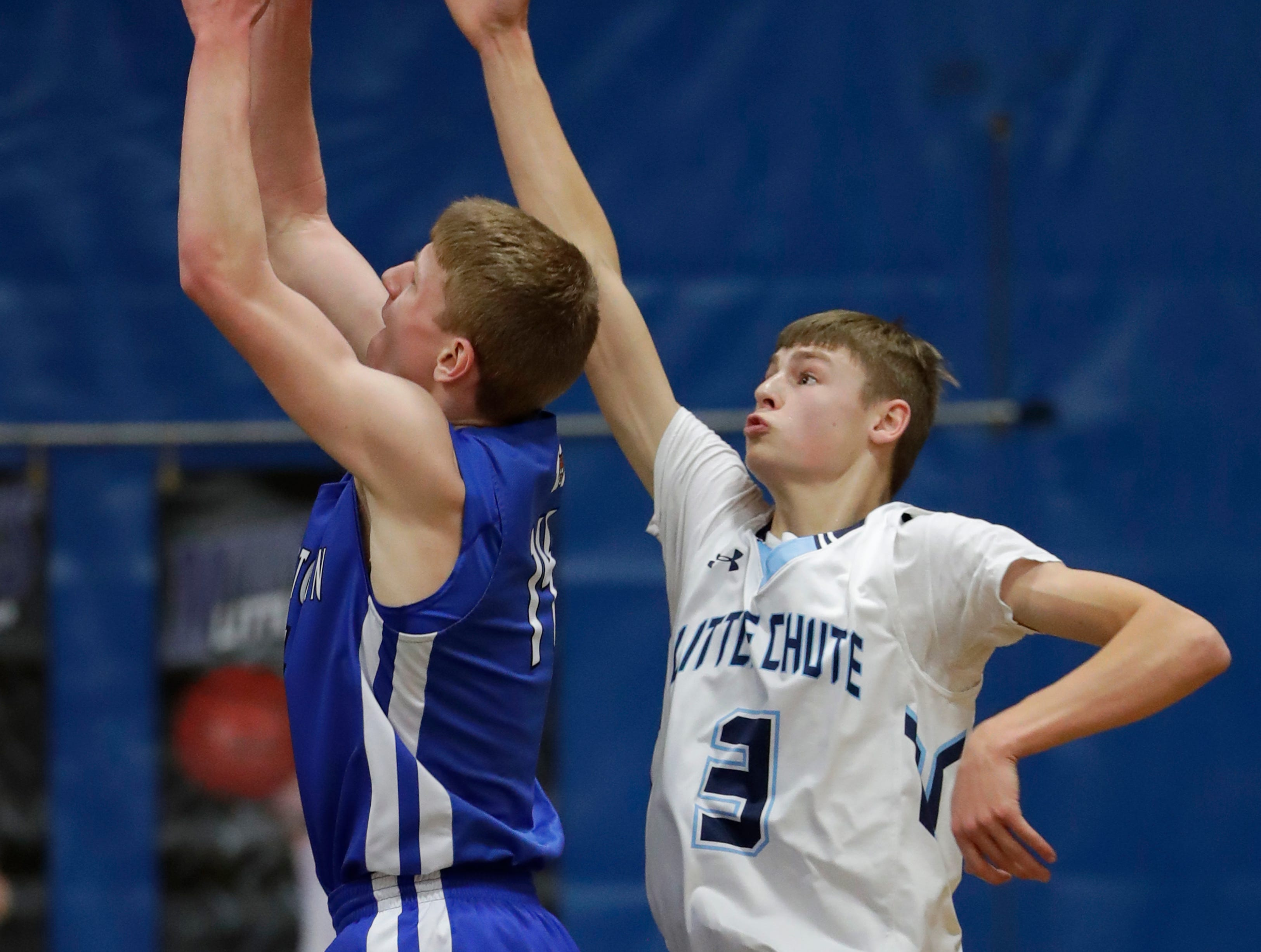 Wrightstown High School's Mayson Hazaert ,left, scores against Little Chute High School's Justin Job during their boys basketball game Friday, February 1, 2019, in Little Chute, Wis. 