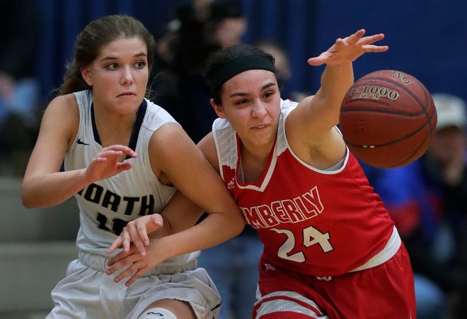 Kimberly's Shea Dechant, right, shown earlier this year against Appleton North, scored 18 points to lead the Papermakers to a victory over Appleton East on Friday night.