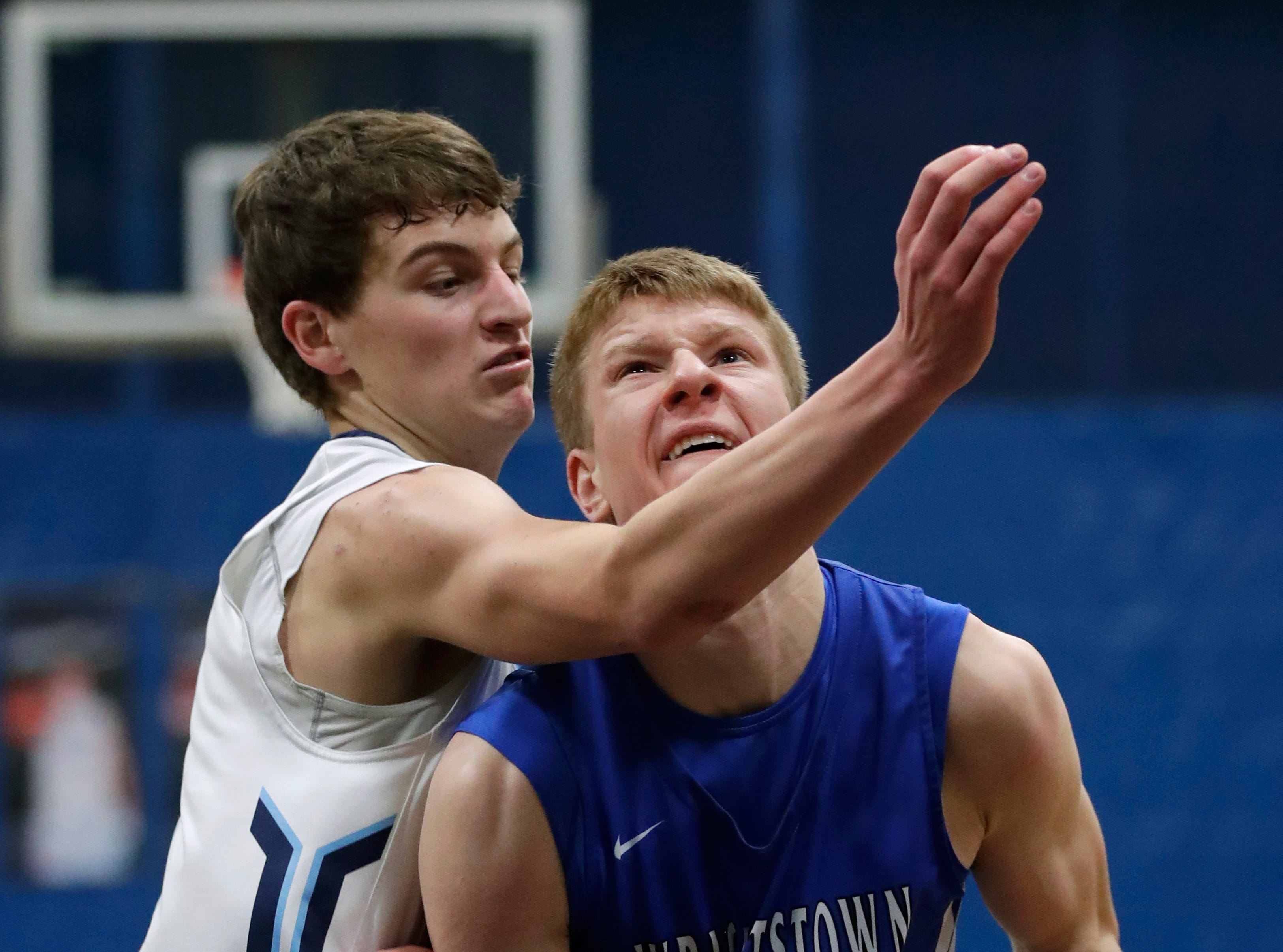 Little Chute High School's Logan Plate, left, commits a foul against Wrightstown High School's Mayson Hazaert as he puts up a shot during their boys basketball game Friday, February 1, 2019, in Little Chute, Wis. 