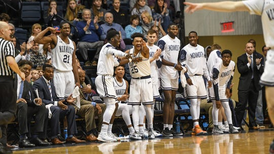 Monmouth players celebrate on the bench during the Hawks' 75-71 victory over Rider on Saturday at OceanFirst Bank Center in West Long Branch.