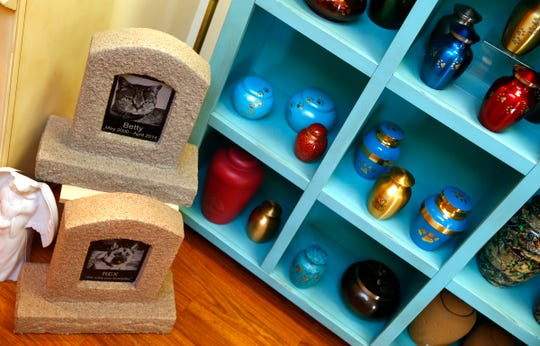 """Containers for pet cremains are shown at """"Forever Remembered Pet Cremation and Memorial Services"""" in  Jackson Township Friday afternoon, February 1, 2019.  The business provides pet removal and honorable pet cremations, funeral and memorial services, and grief counseling following the loss of a pet."""