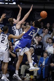 Seton Hall's Myles Powell (13) shoots over Butler's Joey Brunk (50)