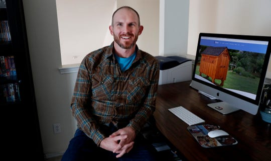 Simon Trask poses for a photo sitting at his home office work desk in Denton, Texas. Trask owns several small businesses and uses different marketing strategies for his young companies including Rita Marie's Chicken Coops and Uppercut Tactical.