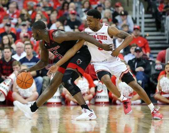 Ohio State Buckeyes guard C.J. Jackson (3) defends Rutgers Scarlet Knights forward Eugene Omoruyi (5) during the first half at Value City Arena. =