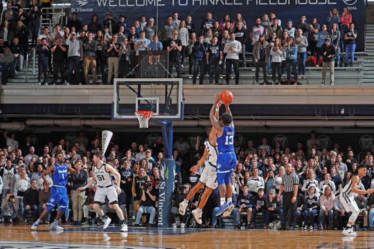 Seton Hall Pirates guard Myles Powell (13) misses a potential game winning three point shot with 3 seconds to go in the game against Butler Bulldogs guard Aaron Thompson (2) during the second half at Hinkle Fieldhouse.