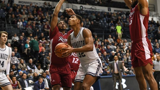 Monmouth's Diago Quinn (32) scored 17 points against Rider on Saturday at OceanFirst Bank Center in West Long Branch.