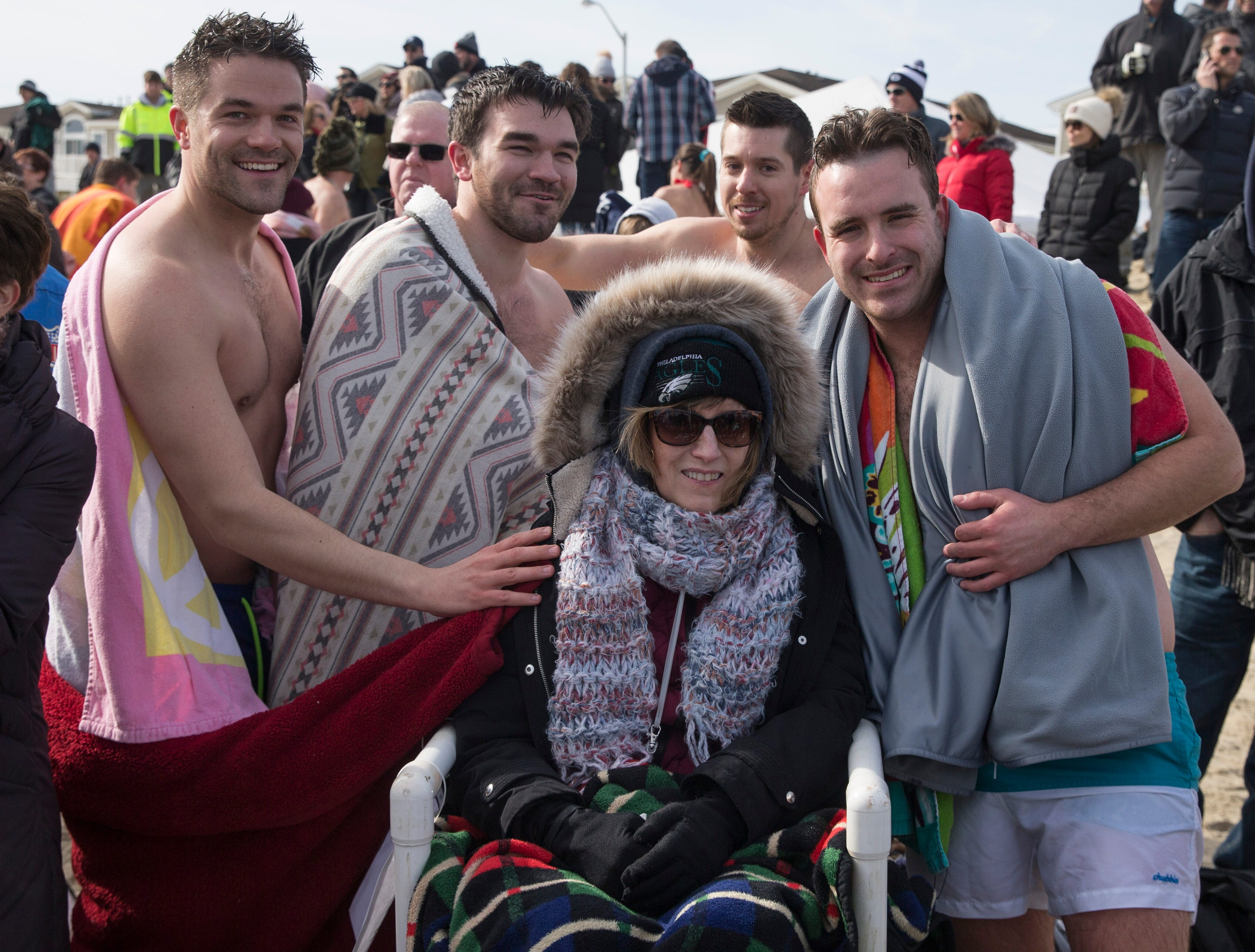 Julie Camastra of Ewing, center, is surrounded by friends and family who support her. The annual Valentine Plunge to raise funds for Joan Dancy and P.A.L.S., which raises money to support local people with ALS (Lou Gehrig's disease), takes place at Manasquan Beach.       Manasquan, NJSaturday, February 2, 2019