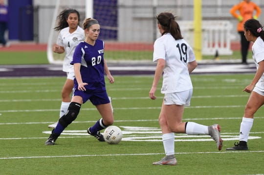 Wylie's Jacqueline Williams (20) waits with the ball early in the season against Odessa Permian. Williams signed her National Letter of Intent to play at NCAA Division II Southern Missouri State next year.