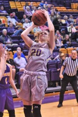 HSU's Samantha Newton (20) steps back for a shot against No. 6 Mary Hardin-Baylor. Newton scored five points off the bench in the Cowgirls upset victory.