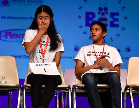 Sanay Salvi (left) applauds Neila Carias who wipes her eye after winning the 20th Big Country Spelling Bee at Hardin-Simmons University's Van Ellis Theater. Carias competes at the national bee beginning Monday.