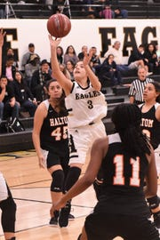 Abilene High's Leila Musquiz (3) floats a shot against Haltom at Eagle Gym on Friday, Feb. 1, 2019. The Lady Eagles won 42-25.