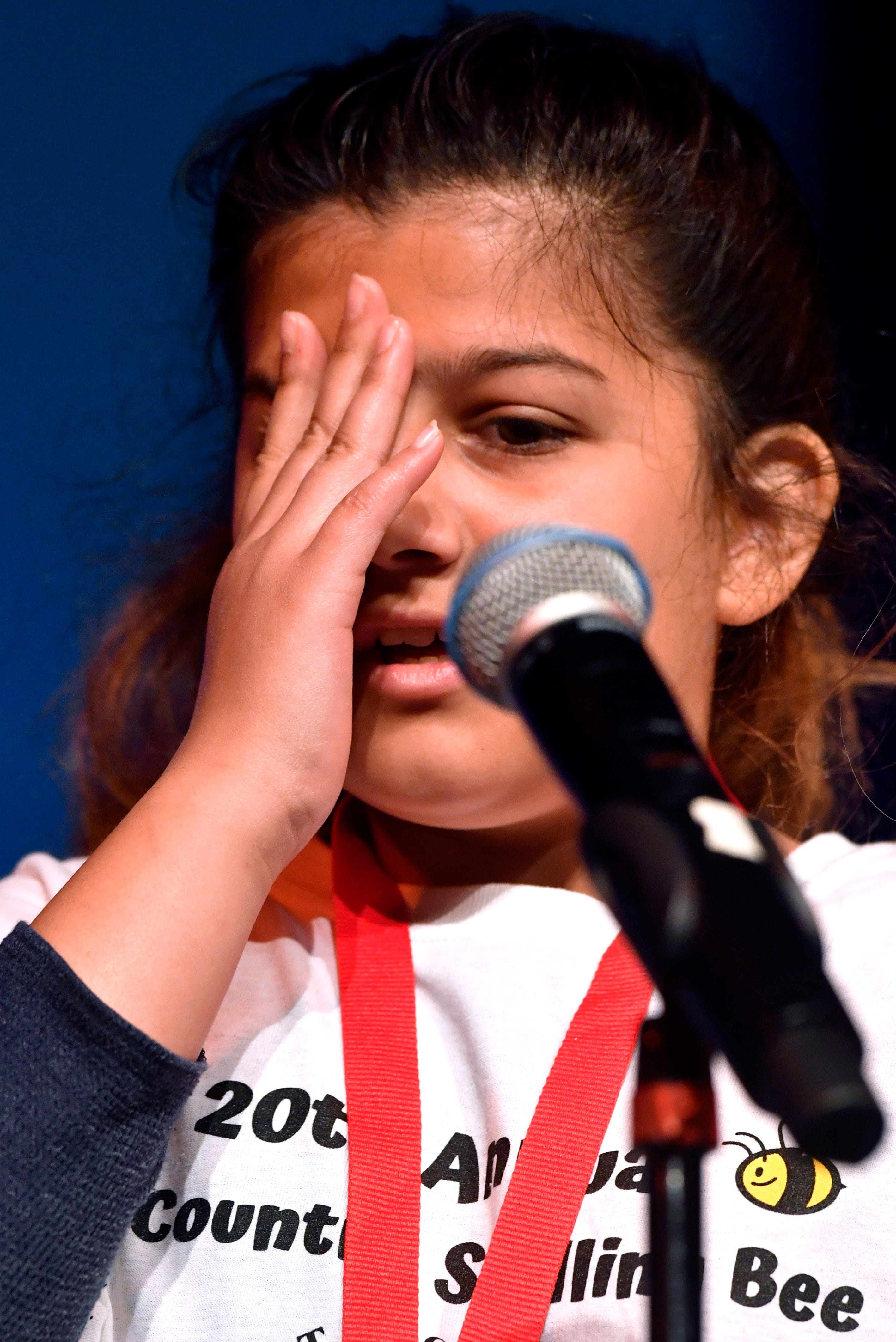 """Vanessa Spencer puts a hand to her face momentarily after hearing the word she had to spell, """"expertise"""", during Saturday's 20th Big Country Spelling Bee at Hardin-Simmons University's Van Ellis Theatre. Vanessa, who attends Dyess Elementary School, successfully spelled the word."""