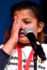 "Vanessa Spencer puts a hand to her face momentarily after hearing the word she had to spell, ""expertise"", during Saturday's 20th Big Country Spelling Bee at Hardin-Simmons University's Van Ellis Theatre. Vanessa, who attends Dyess Elementary School, successfully spelled the word."