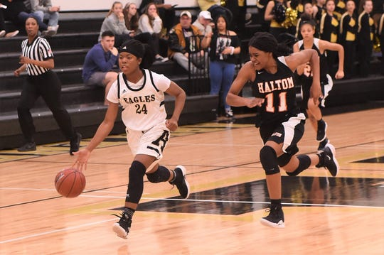Abilene High's Trakenya Roberson (24) runs on a fast break against Haltom at Eagle Gym on Friday, Feb. 1, 2019. Roberson scored 25 in the Lady Eagles 42-25 win.
