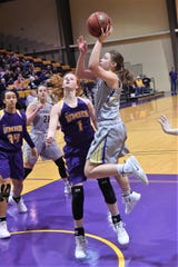 HSU's Ryan Bush (5) goes up for a shot against No. 6 Mary Hardin-Baylor on Saturday. Bush scored 12 points off the bench as the Cowgirls upset No. 6 UMHB 61-59 at the Mabee Complex.