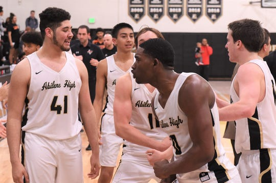 Abilene High's Donte Cuffy (0) celebrates making the game-winning shot at the buzzer to beat Haltom City Haltom 59-57 on Friday.