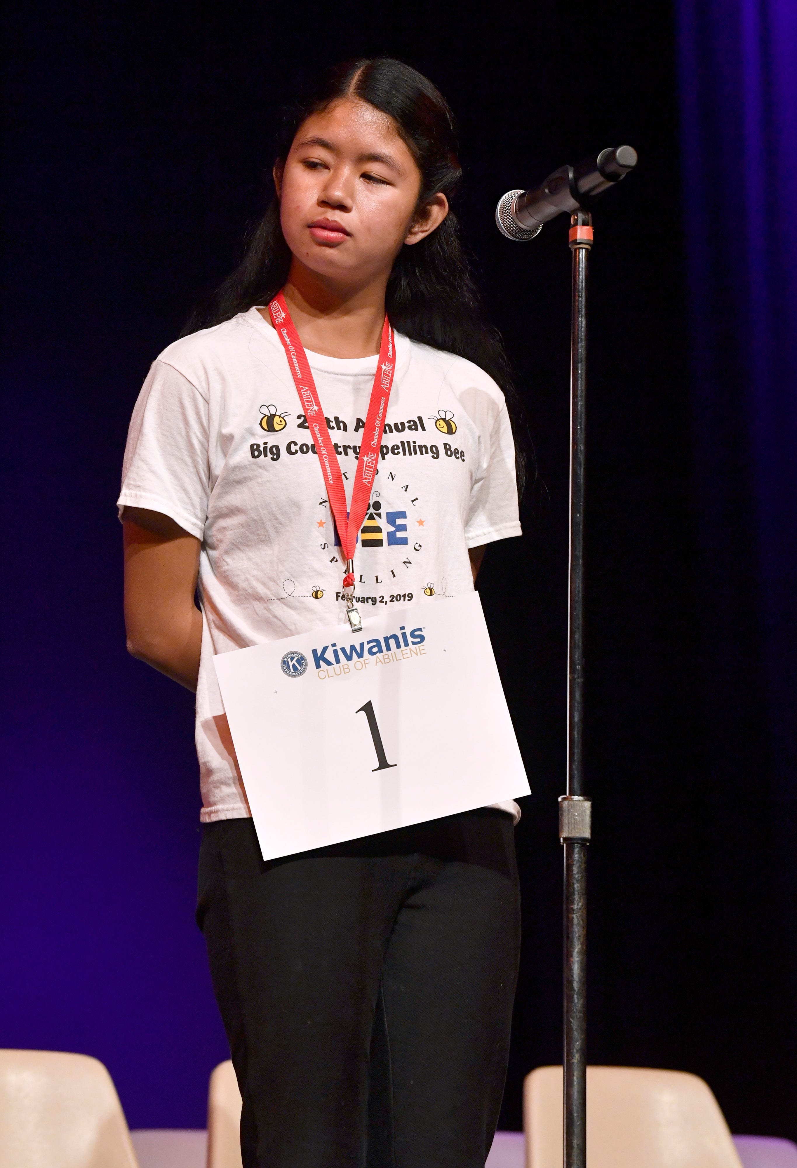 Neila Carias listens to the pronunciation of a word during Saturday's 20th Big Country Spelling Bee. Neila, a student at Clack Middle School, was the winner in the contest at Hardin-Simmons University's Van Ellis Theatre.